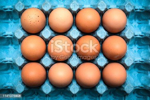 Fresh organic eggs in cardboard tray