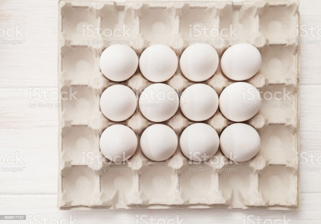 eggs, white background, table, packaging for eggs made of cardboard stock photo