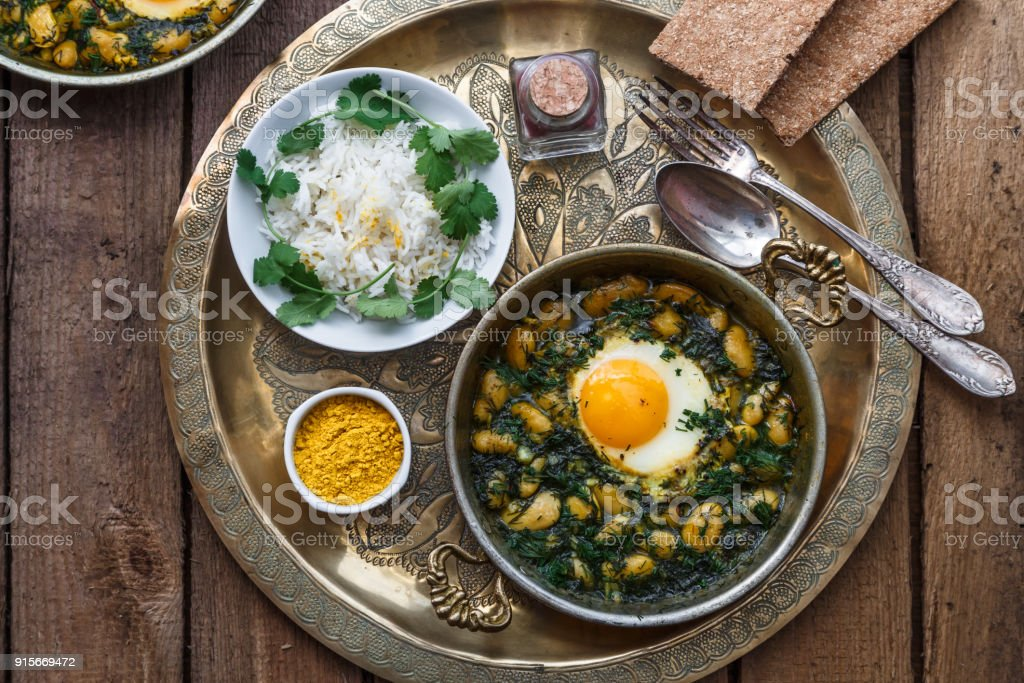 Eggs with bean, dill and rice. Iranian breakfast stock photo