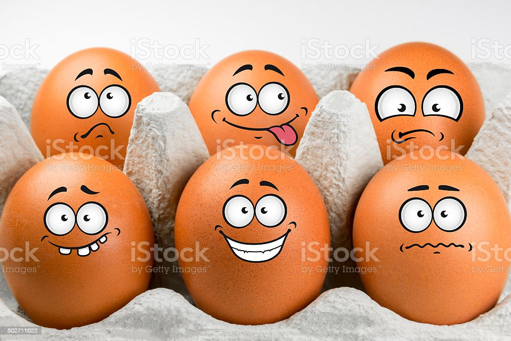 Eggs with faces and various expressions. stock photo