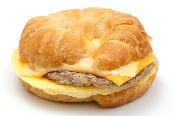 egg,sausage, andd cheese croissant stock photo