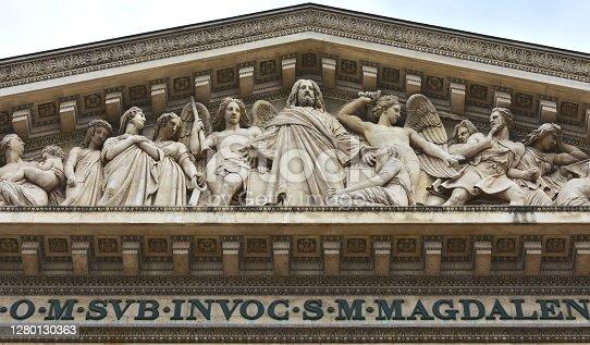 istock Eglise de la Madeleine, frieze detail with Last Judgment scene. Paris, France. 1280130363
