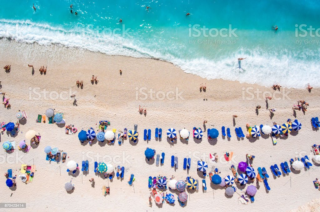 Egremni Beach Lefkada tourists relaxing on the beach, swimming and playing games on a hot summer day stock photo