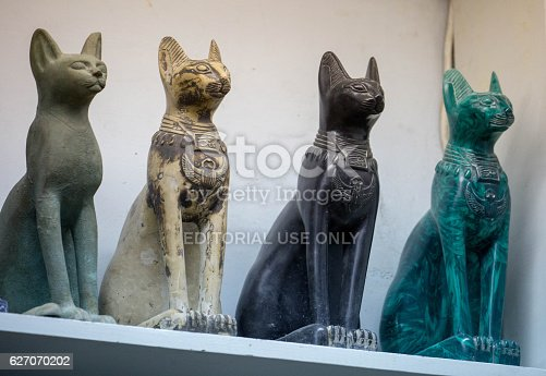 Luxor, Egypt - July 26, 2016: A row of carved alabaster cats available as souvenirs in Luxor.