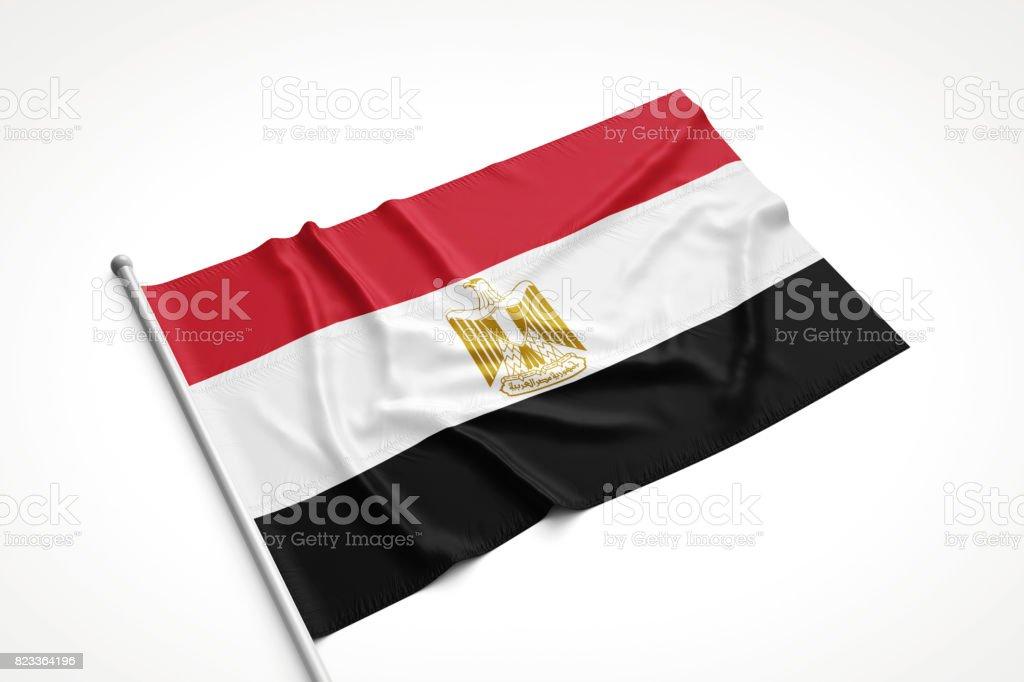 Bandera de Egipto es recostado sobre una superficie blanca - foto de stock