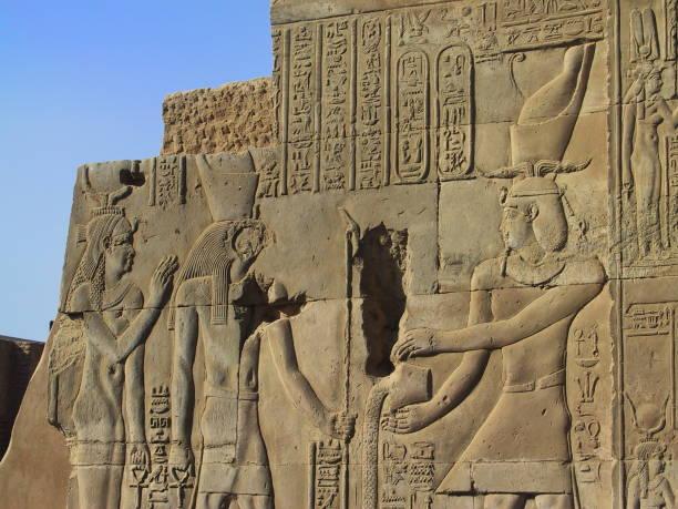 Egypt. Kom Ombo. Pharaoh in front of Haroeris and Hathor. stock photo