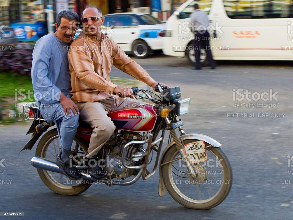 Egypt Luxor Motorcycle Men royalty-free stock photo