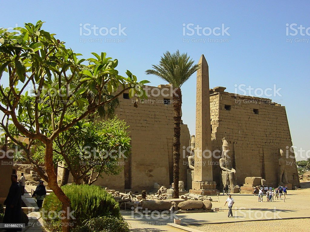 Egypt Luxor. Temple entrance Pylon with obelisk at dawn. stock photo