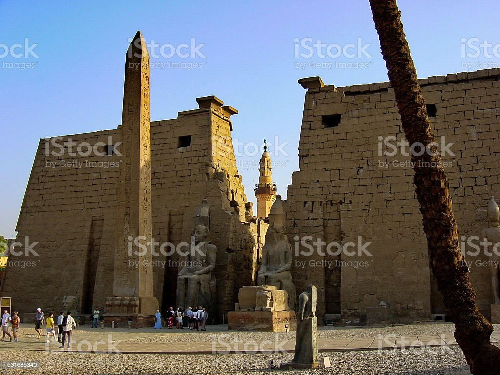 Egypt Luxor. Temple entrance Pylon with obelisk at sundown. stock photo