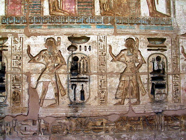 Egypt Luxor, West Bank. Painted  Relief at Medinet Habu Temple. Painted Relief, Medinet Habu, Tomb Of Ramses III stock pictures, royalty-free photos & images