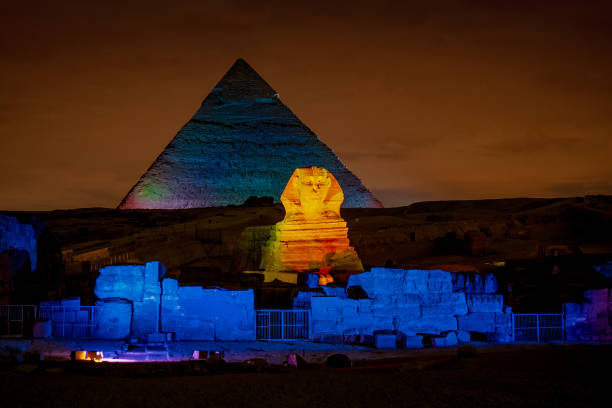 Egypt night at the Pyramids with the Sphinx iluminated in Giza Plateau Cairo stock photo