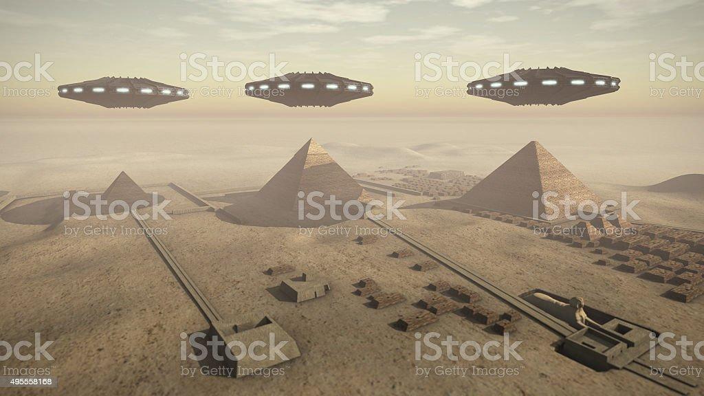 Egypt pyramids with UFOs stock photo