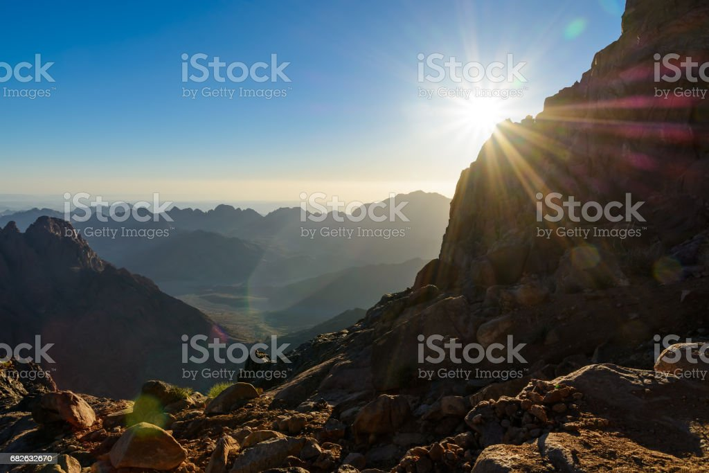 Egypt, Sinai, Mount Moses. View from road on which pilgrims climb the mountain of Moses and dawn - morning sun with rays on the sky. - foto de acervo