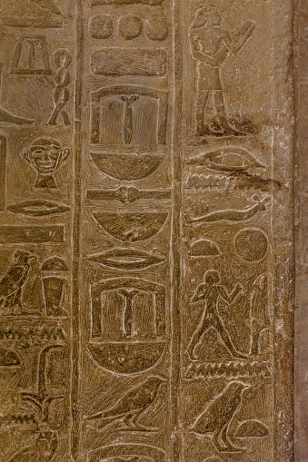614744994 istock photo Egyptian ancient hieroglyphs on the stone wall 1093841944