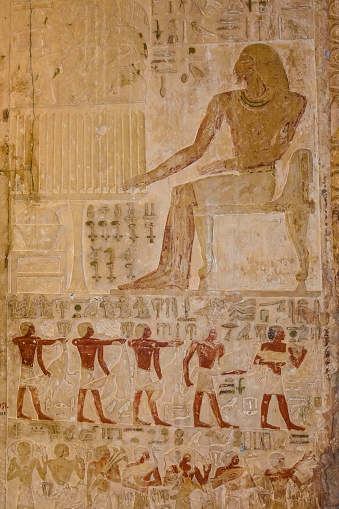 614744994 istock photo Egyptian ancient hieroglyphs on the stone wall 1131771514