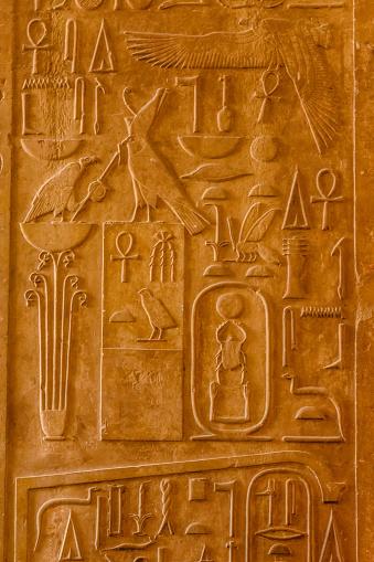 614744994 istock photo Egyptian ancient hieroglyphs on the stone wall 1131771515