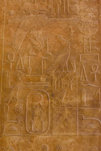 614744994 istock photo Egyptian ancient hieroglyphs on the stone wall 1132354816
