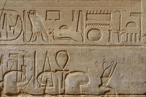 614744994 istock photo Egyptian ancient hieroglyphs on the stone wall 1152980117