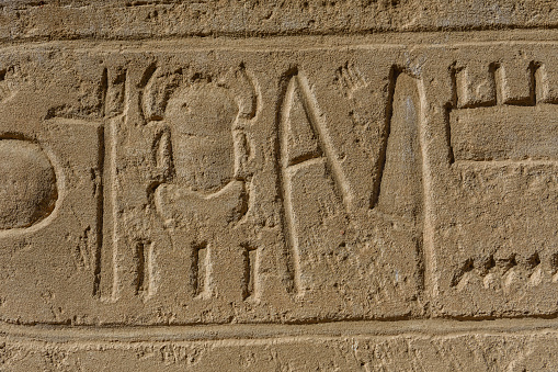 614744994 istock photo Egyptian ancient hieroglyphs on the stone wall 1152980121