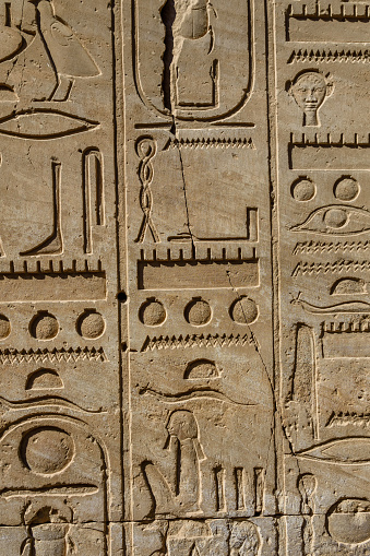 614744994 istock photo Egyptian ancient hieroglyphs on the stone wall 1153912575