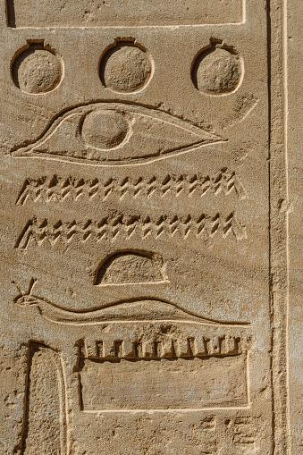 614744994 istock photo Egyptian ancient hieroglyphs on the stone wall 1155500678