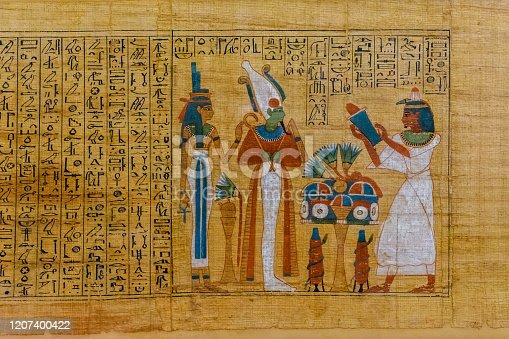 istock Egyptian ancient papyrus with the different pictures and hieroglyphics 1207400422