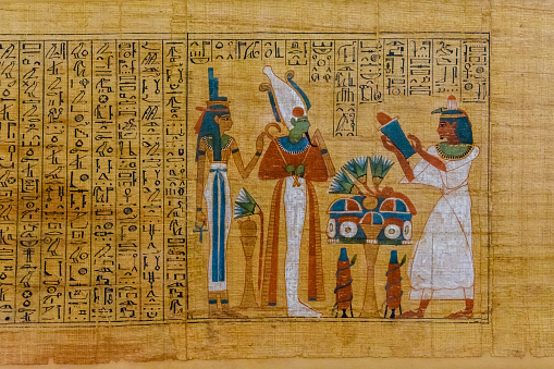 Egyptian ancient papyrus with the different pictures and hieroglyphics