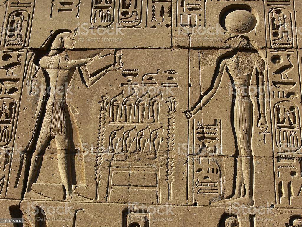 Egyptian basrelief and hieroglyphs royalty-free stock photo