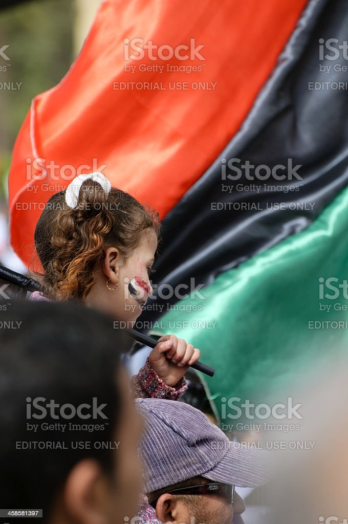 Egyptian girl and Libyan flag stock photo