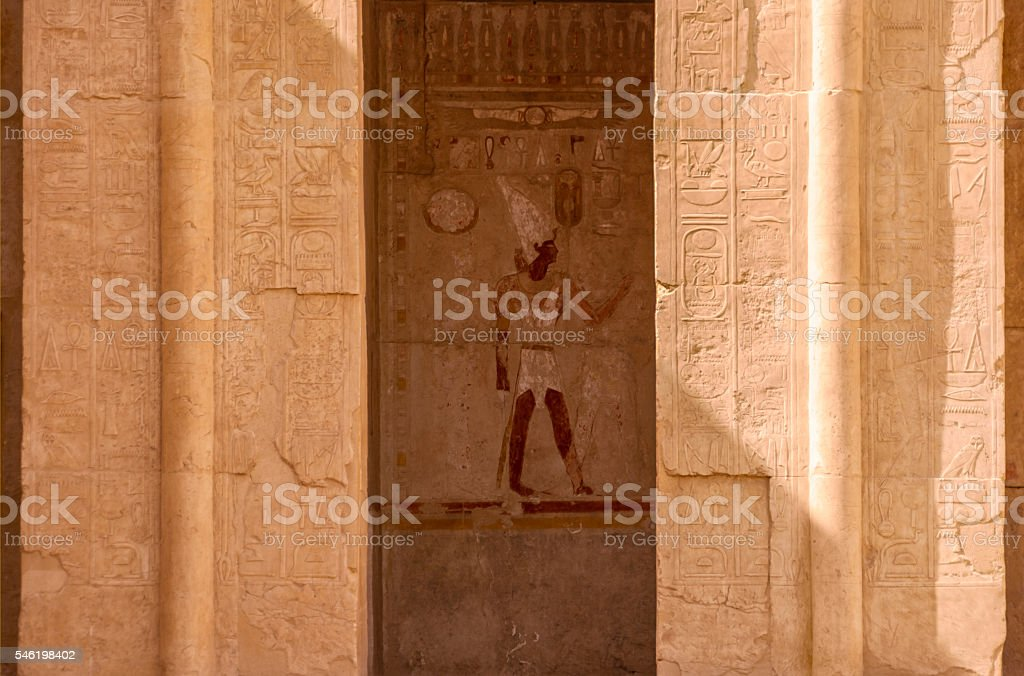 Egyptian god in niche surrounded by hieroglyph carvings, Luxor, Egypt stock photo