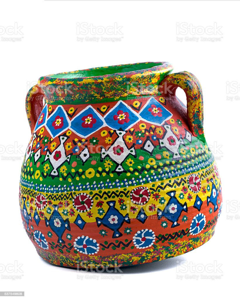 Egyptian handcrafted decorated artistic pottery jar on white background stock photo