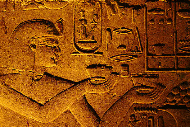 Egyptian hiearoglifs Egyptian hiearoglifs on the wall of Luxor temple valley of the kings stock pictures, royalty-free photos & images
