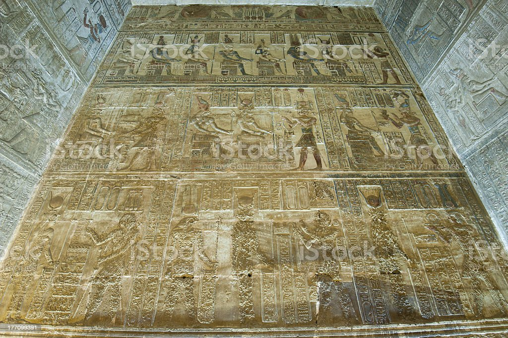 Egyptian hieroglyphic paintings on a temple wall stock photo