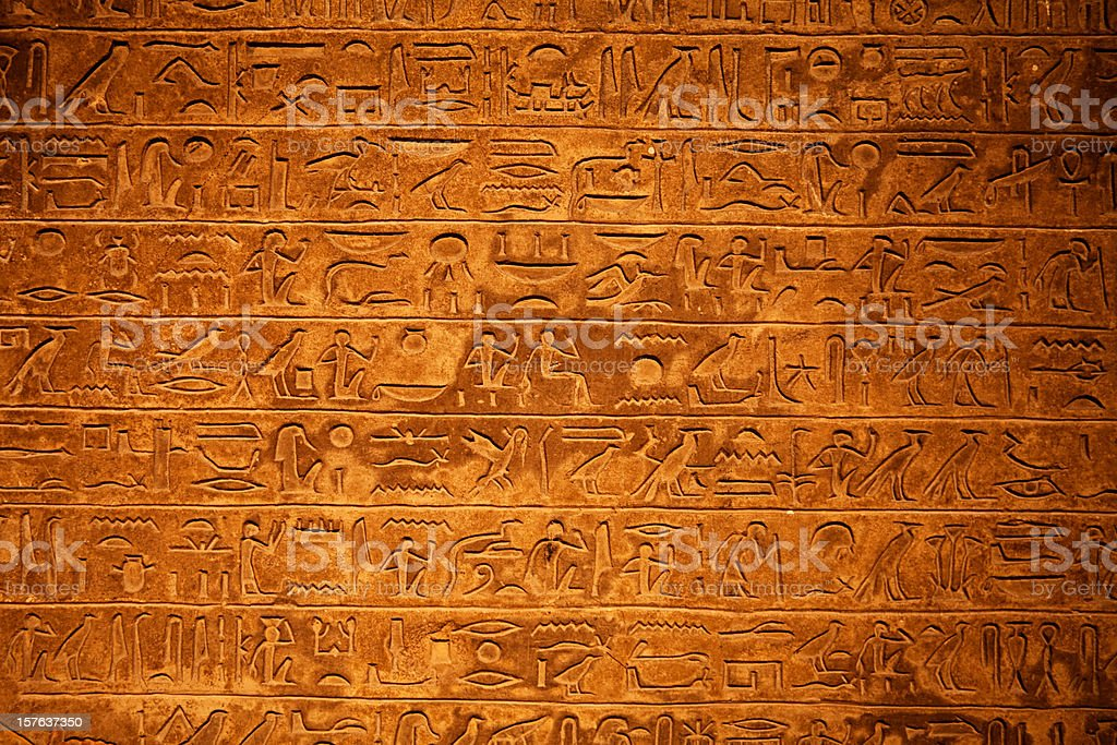 Egyptian Hieroglyphics on a beige stone stock photo