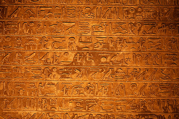 egyptian hieroglyphics on a beige stone - egyptisk kultur bildbanksfoton och bilder