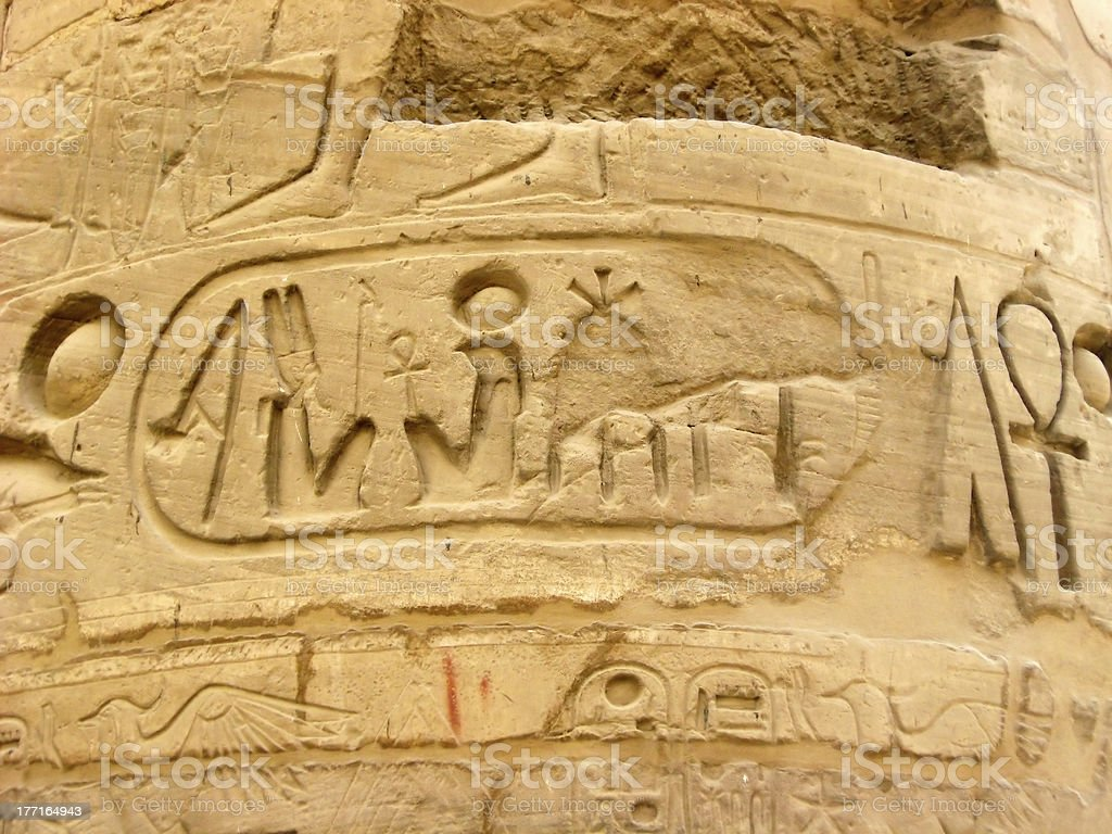 Egyptian hieroglyphics on the stone column royalty-free stock photo