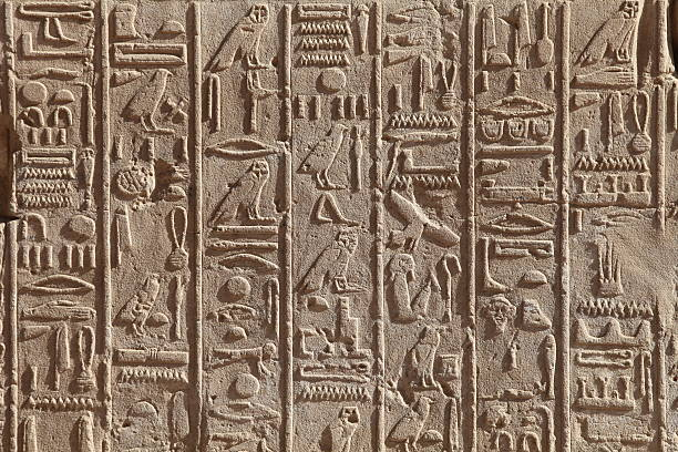 Egyptian hieroglyphics Egyptian hieroglyphics on the stone wall ancient civilization stock pictures, royalty-free photos & images
