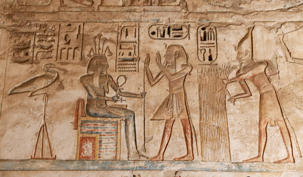 Egyptian Hieroglyphs in Medinet Habu Temple, Luxor, Egypt Egyptian Hieroglyphs in Medinet Habu Temple, Luxor City, Egypt Tomb Of Ramses III stock pictures, royalty-free photos & images