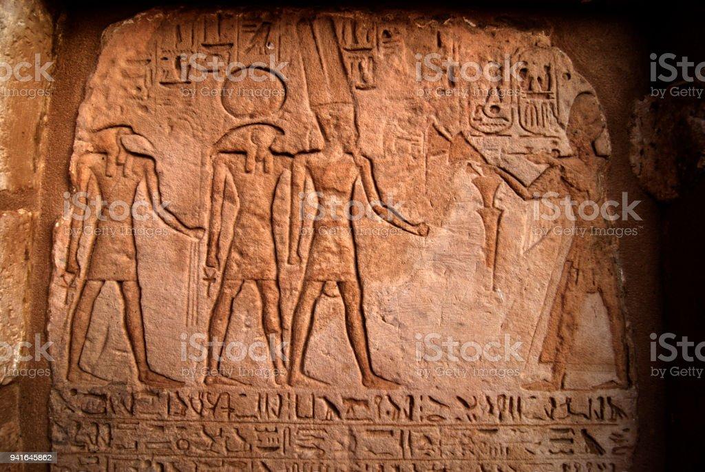 Egyptian mythology on the wall of Abu Simbel temple, Aswan of Egypt-2009 stock photo