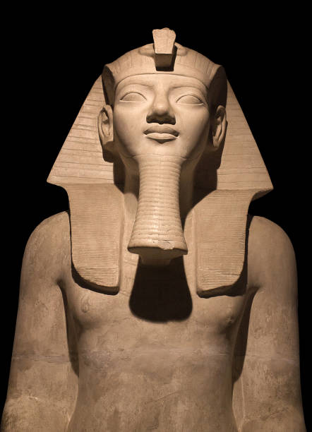 Egyptian Pharaoh Statue isolated on black background stock photo