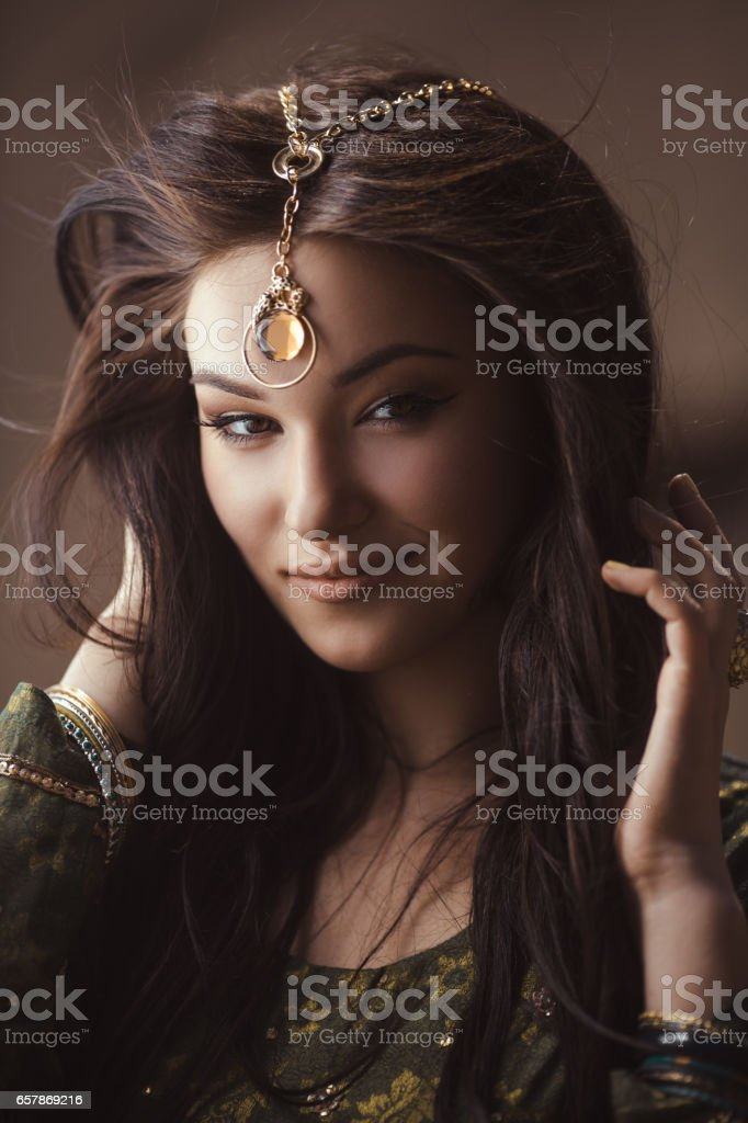 Egyptian princess Cleopatra in desert stock photo