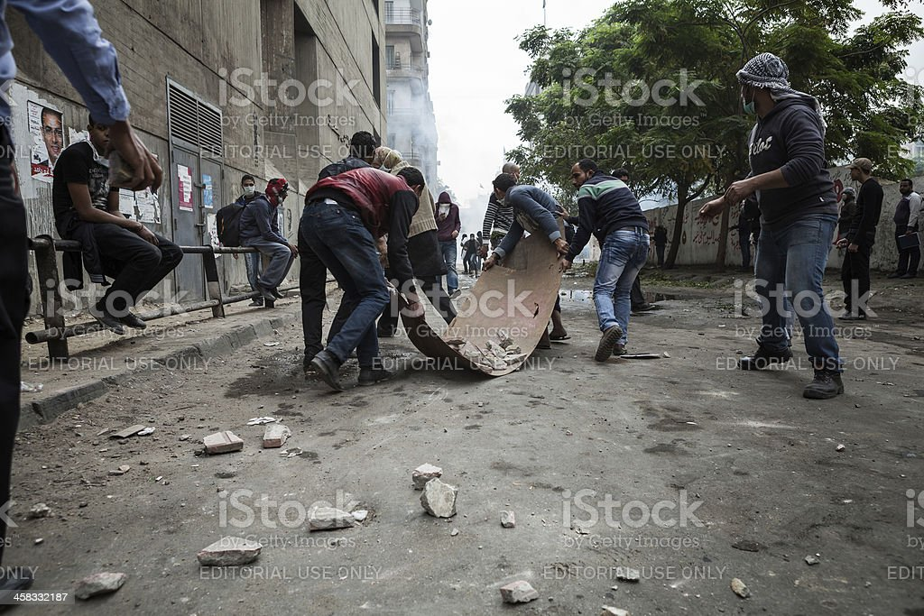 Egyptian protesters supports with rocks stock photo