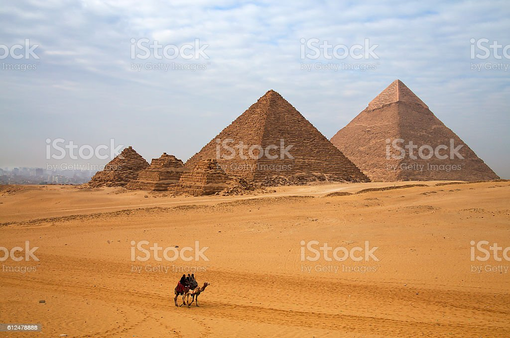 Egyptian pyramid and the rider on the camel stock photo