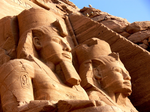 Egyptian pyramid statues in the sunset