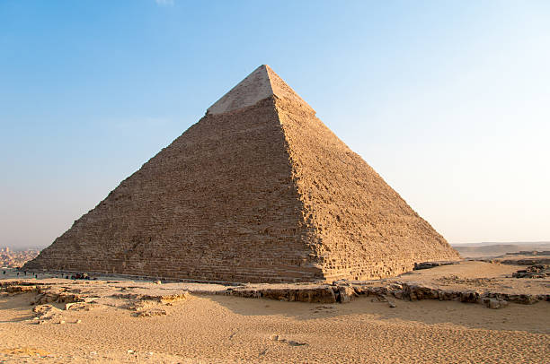 egyptian pyramids of the giza plateau, cairo - pyramid stock photos and pictures