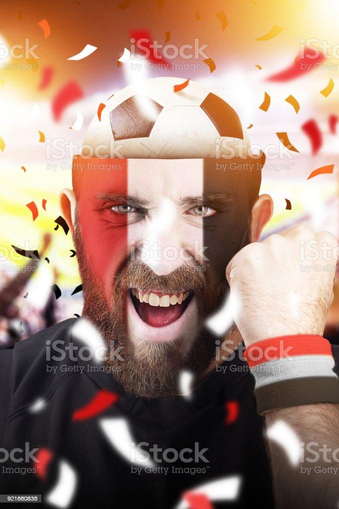 Egyptian soccer fan with football inside the head - foto stock