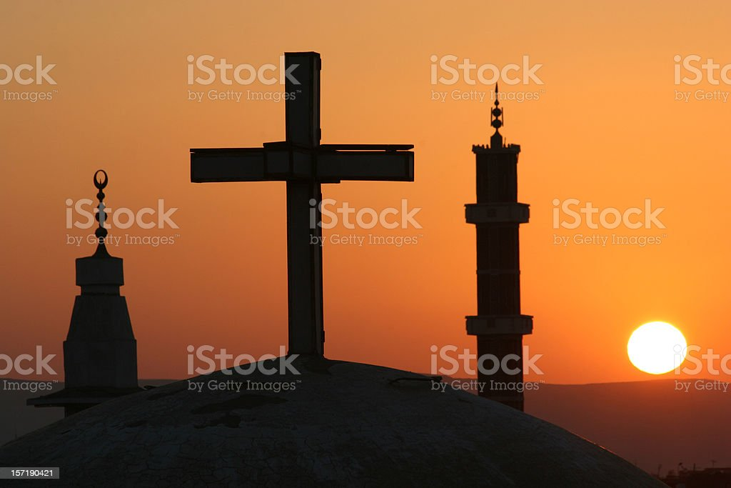 Egyptian sunrise with cross and crescents stock photo