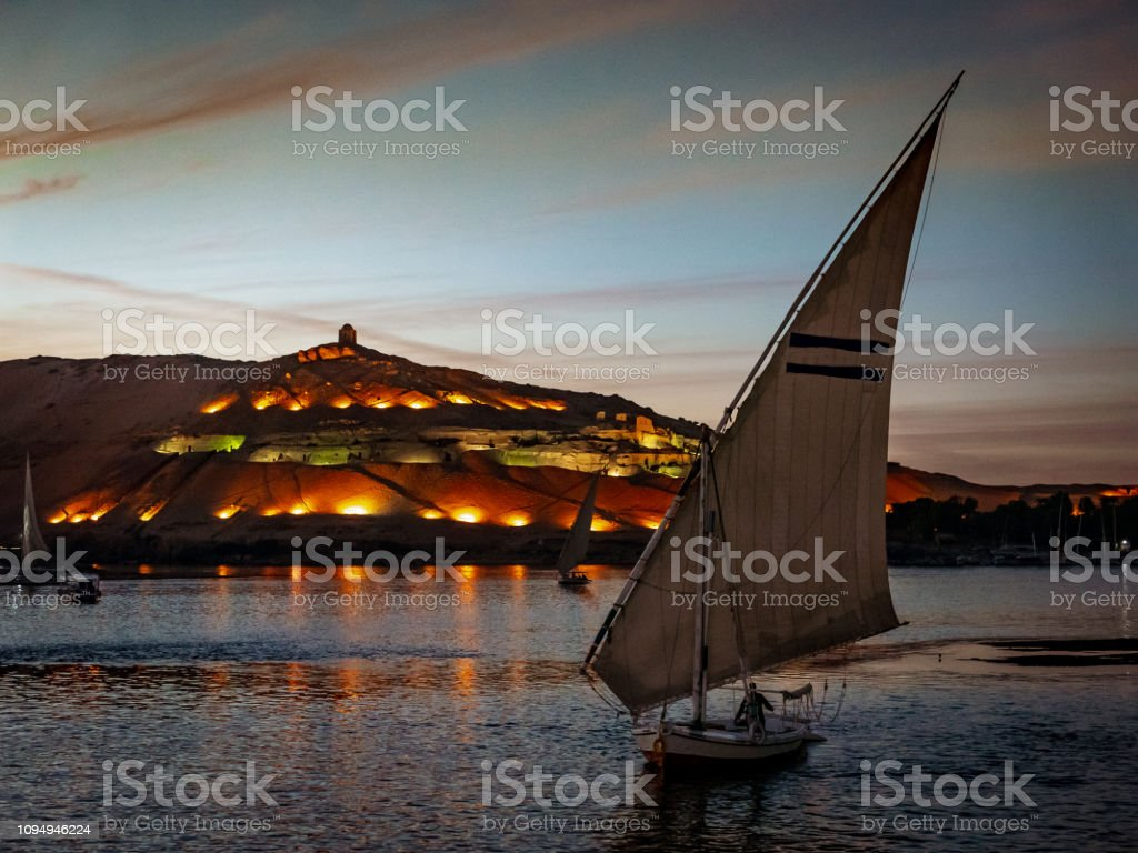 Egyptian Sunset On The Nile With Felucca Boat Stock Photo - Download