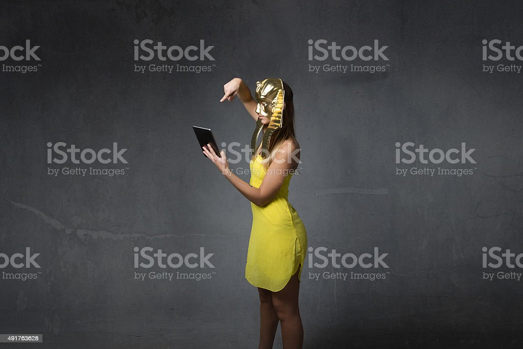 egyptian woman using tablet stock photo