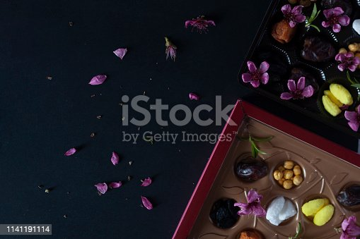 istock Eid Mubarak. Different iftar sweets. Celebrating Eid Al Adha. Islamic traditional holiday. Eid al-Fitr. Holly month Ramadan. Middle Eastern religious holiday. Dried date fruit. Flat lay, top view. 1141191114
